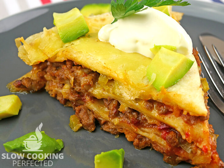 Layered beef enchiladas cooked in a slow cooker