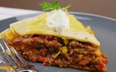 Delicious Layered Slow Cooker Beef Enchiladas