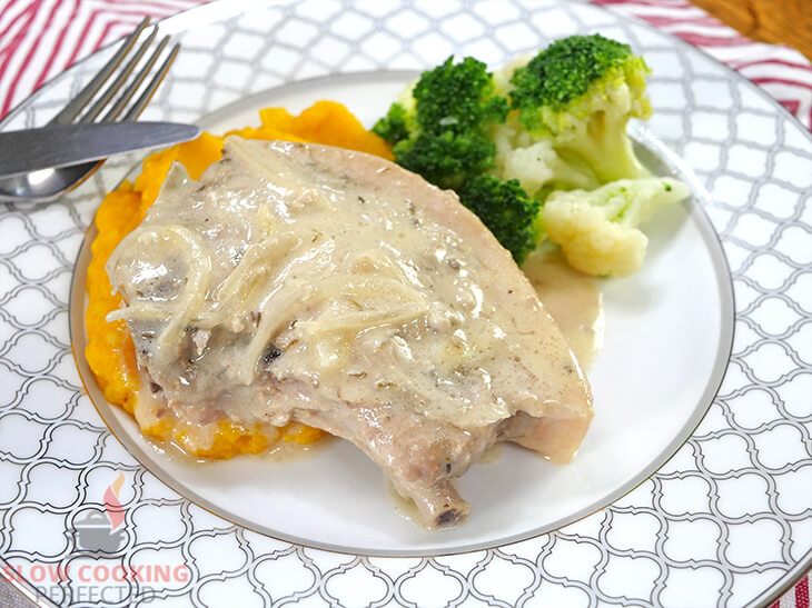 Smothered Pork Chops with mashed sweet potatoes and broccoli