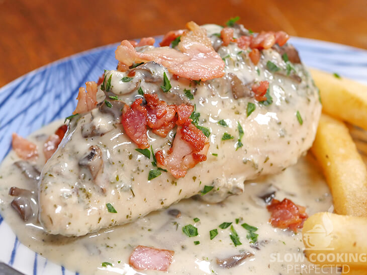 Slow Cooker Ranch Chicken with a Creamy Sauce and topped with Bacon