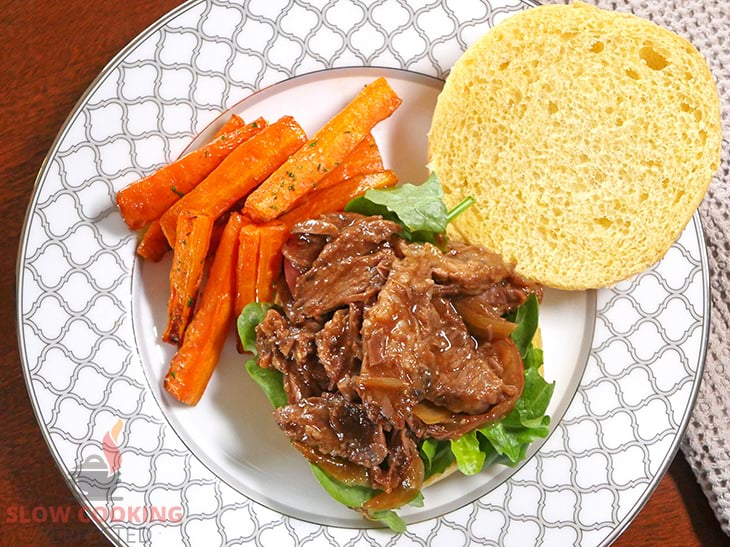 Slow-cooked BBQ Beef on a bread roll with lettuce